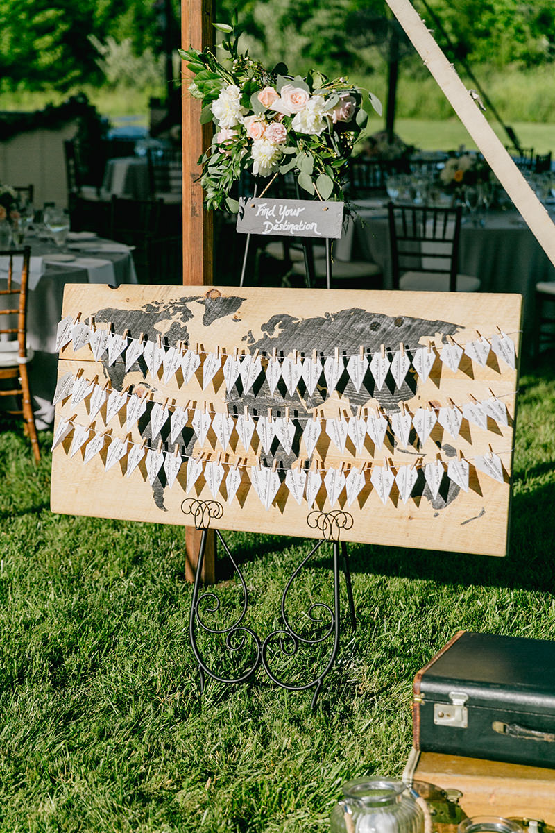 unique seating chart ideas - photo by Emily Wren Photography https://ruffledblog.com/bright-beautiful-summer-wedding-with-geometric-accents