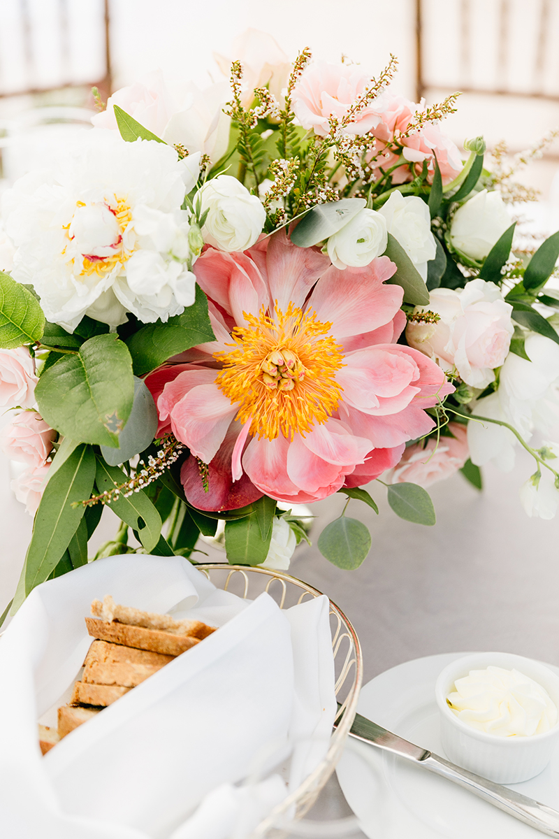 coral charm peony centerpieces - photo by Emily Wren Photography https://ruffledblog.com/bright-beautiful-summer-wedding-with-geometric-accents