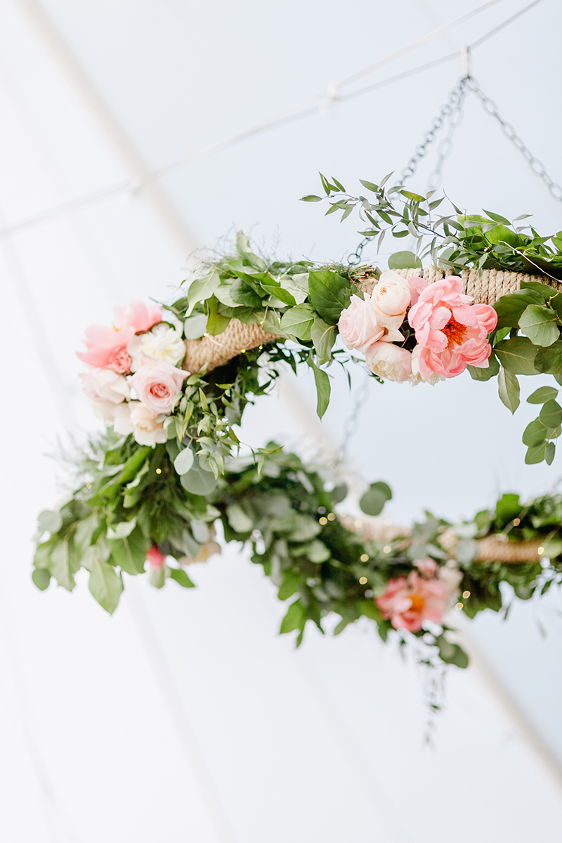 floral wreaths - photo by Emily Wren Photography https://ruffledblog.com/bright-beautiful-summer-wedding-with-geometric-accents