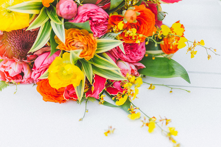 bright yellow and pink bouquets - https://ruffledblog.com/bright-colorful-destination-wedding-in-maui