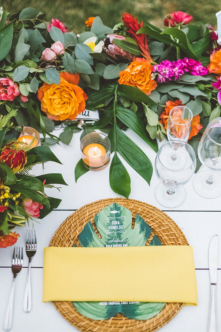 tropcial wedding tablescapes with bright flowers - https://ruffledblog.com/bright-colorful-destination-wedding-in-maui