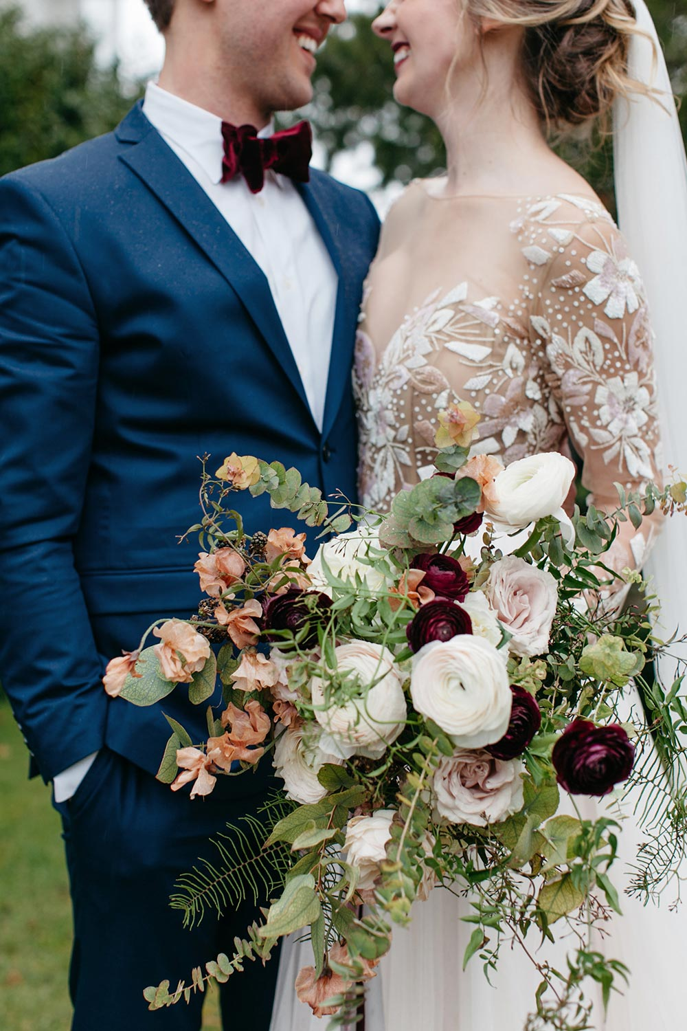 Hayley paige long sleeve wedding dress with earth toned bridal bouquet