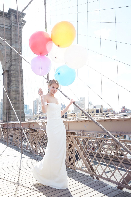 of the shoulder wedding dress on Brooklyn bridge
