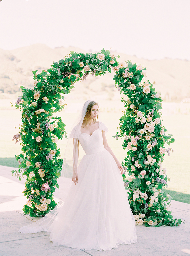 Charming Wedding Inspiration with a Lush Floral Arch - photo by This Love of Yours Photography https://ruffledblog.com/charming-wedding-inspiration-with-a-lush-floral-arch