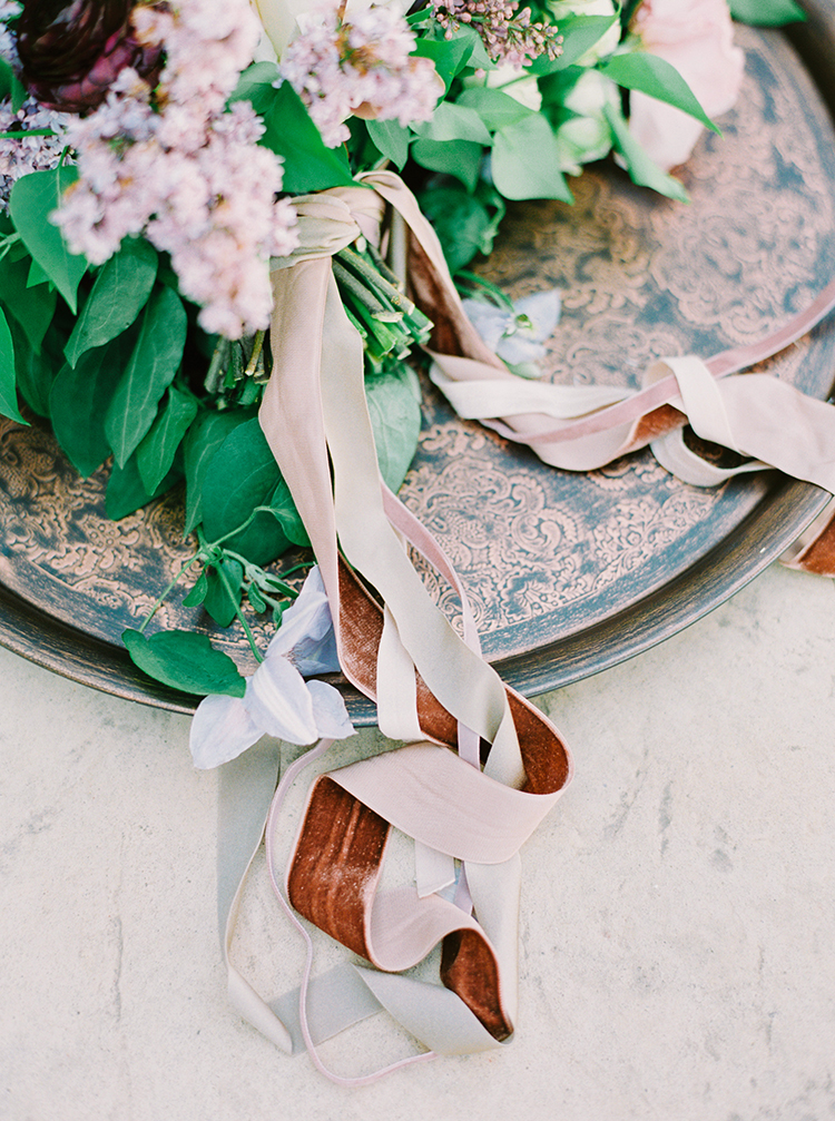 romantic wedding ribbons - photo by This Love of Yours Photography http://ruffledblog.com/charming-wedding-inspiration-with-a-lush-floral-arch