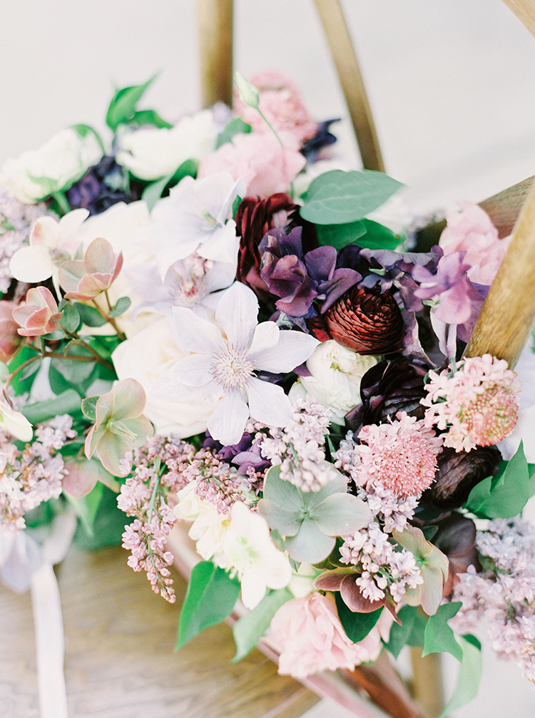 purple and pink wedding bouquets - photo by This Love of Yours Photography https://ruffledblog.com/charming-wedding-inspiration-with-a-lush-floral-arch
