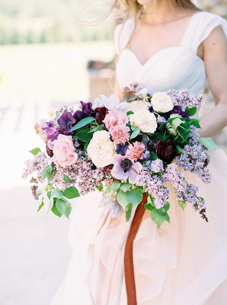 romantic purple wedding bouquets - photo by This Love of Yours Photography https://ruffledblog.com/charming-wedding-inspiration-with-a-lush-floral-arch