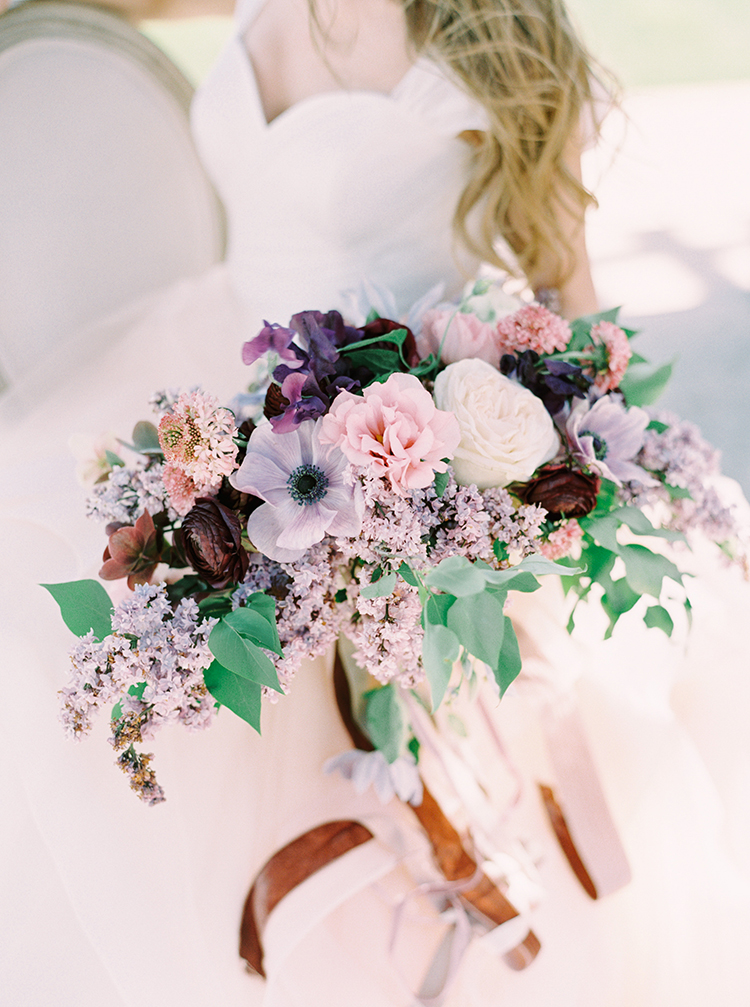 wedding bouquets with pink and purple blooms - photo by This Love of Yours Photography https://ruffledblog.com/charming-wedding-inspiration-with-a-lush-floral-arch
