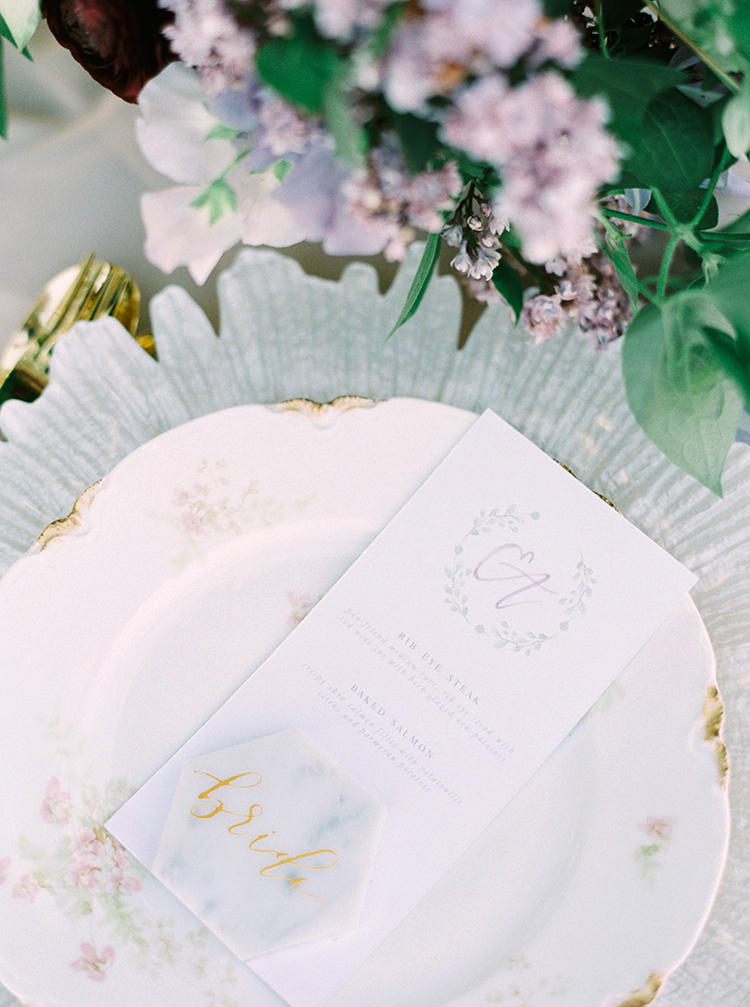 romantic vintage table settings - photo by This Love of Yours Photography http://ruffledblog.com/charming-wedding-inspiration-with-a-lush-floral-arch