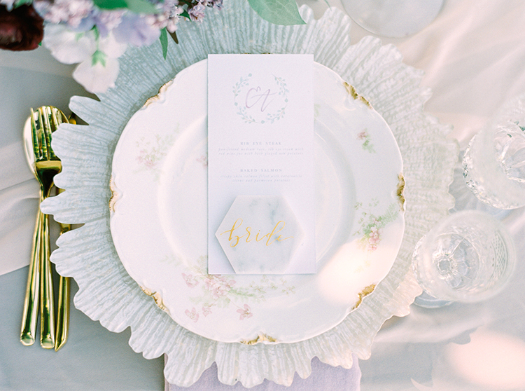 place settings with vintage china and marble accents - photo by This Love of Yours Photography http://ruffledblog.com/charming-wedding-inspiration-with-a-lush-floral-arch