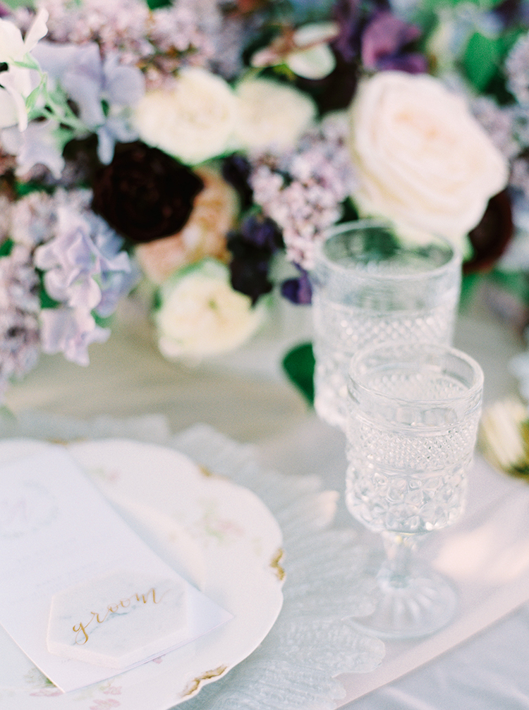 wedding reception table details - photo by This Love of Yours Photography http://ruffledblog.com/charming-wedding-inspiration-with-a-lush-floral-arch