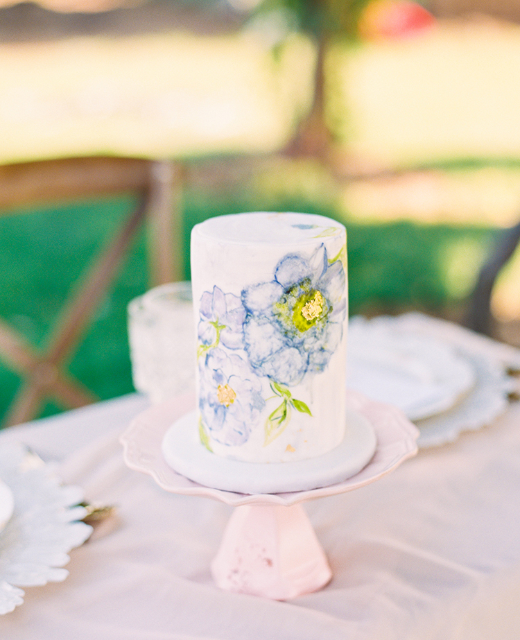 wedding cakes with painted flowers - photo by This Love of Yours Photography https://ruffledblog.com/charming-wedding-inspiration-with-a-lush-floral-arch