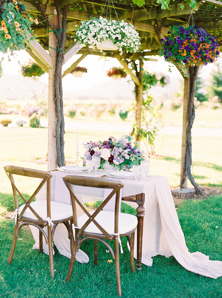 romantic wedding tables - photo by This Love of Yours Photography http://ruffledblog.com/charming-wedding-inspiration-with-a-lush-floral-arch