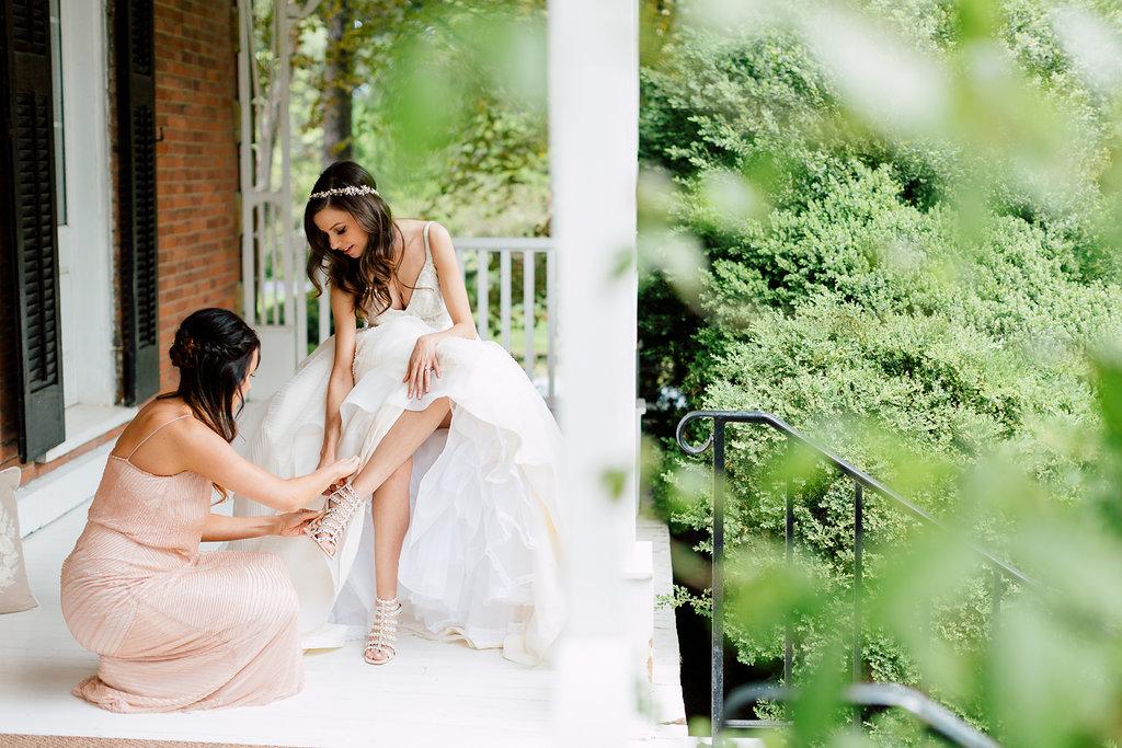 bride getting ready - photo by Purple Tree Photography https://ruffledblog.com/charming-wine-country-wedding-at-kurtz-orchard