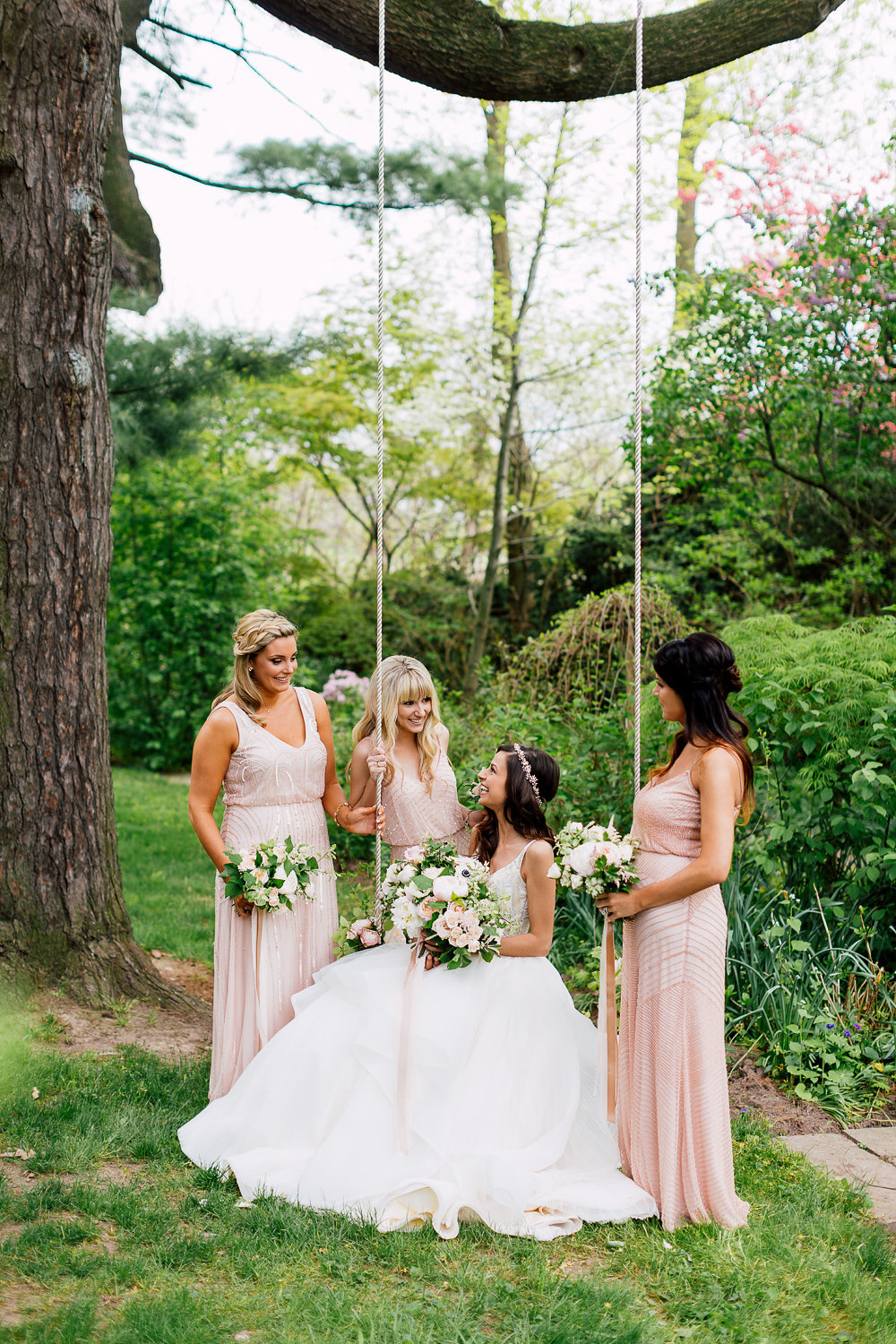 bride and bridesmaids - photo by Purple Tree Photography http://ruffledblog.com/charming-wine-country-wedding-at-kurtz-orchard
