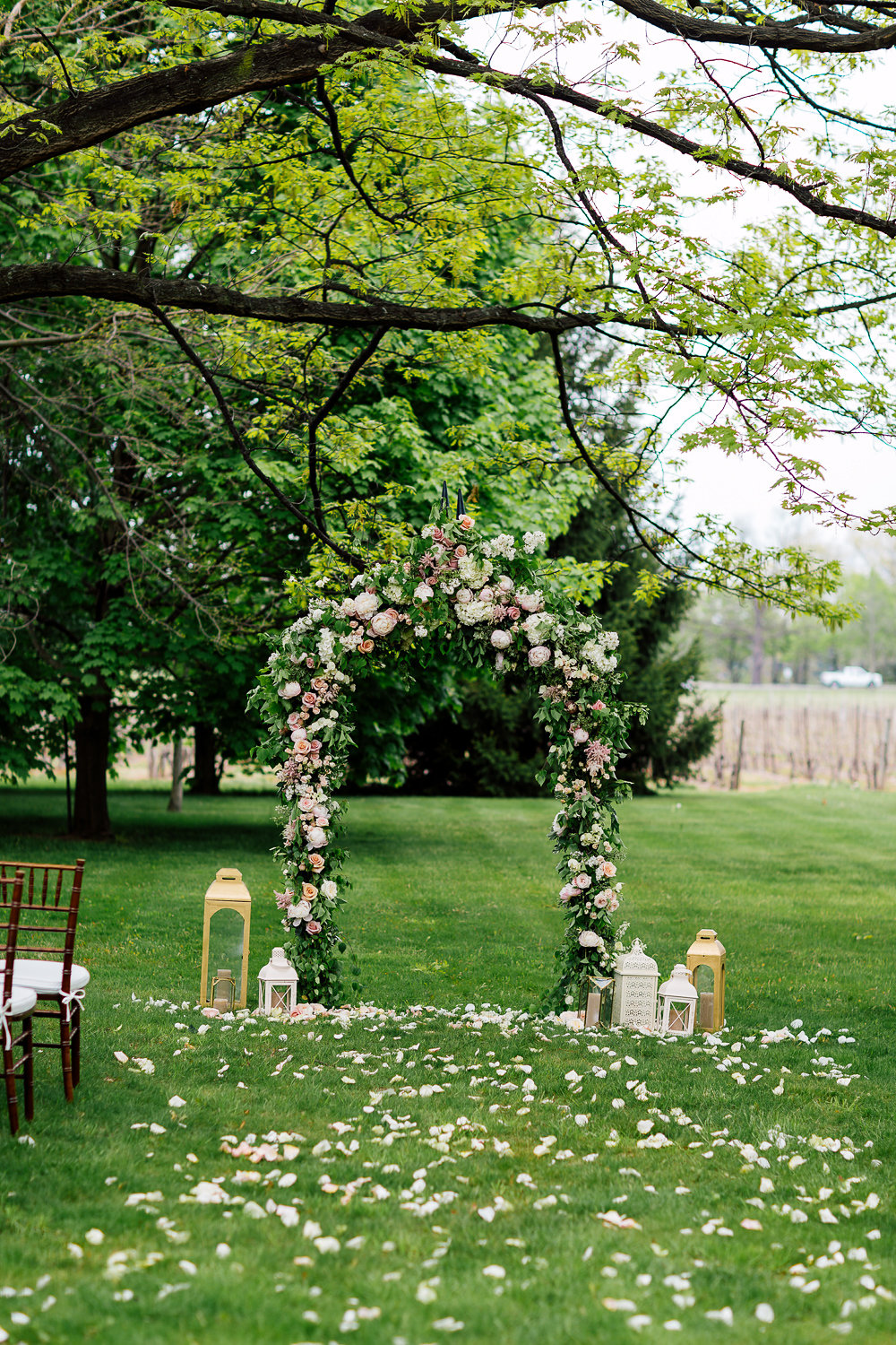 floral ceremony arch - photo by Purple Tree Photography https://ruffledblog.com/charming-wine-country-wedding-at-kurtz-orchard