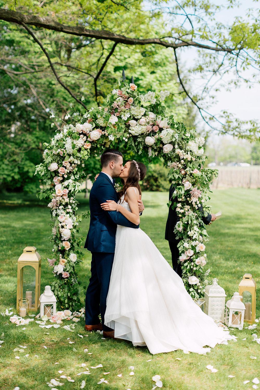 ceremony kisses - photo by Purple Tree Photography https://ruffledblog.com/charming-wine-country-wedding-at-kurtz-orchard
