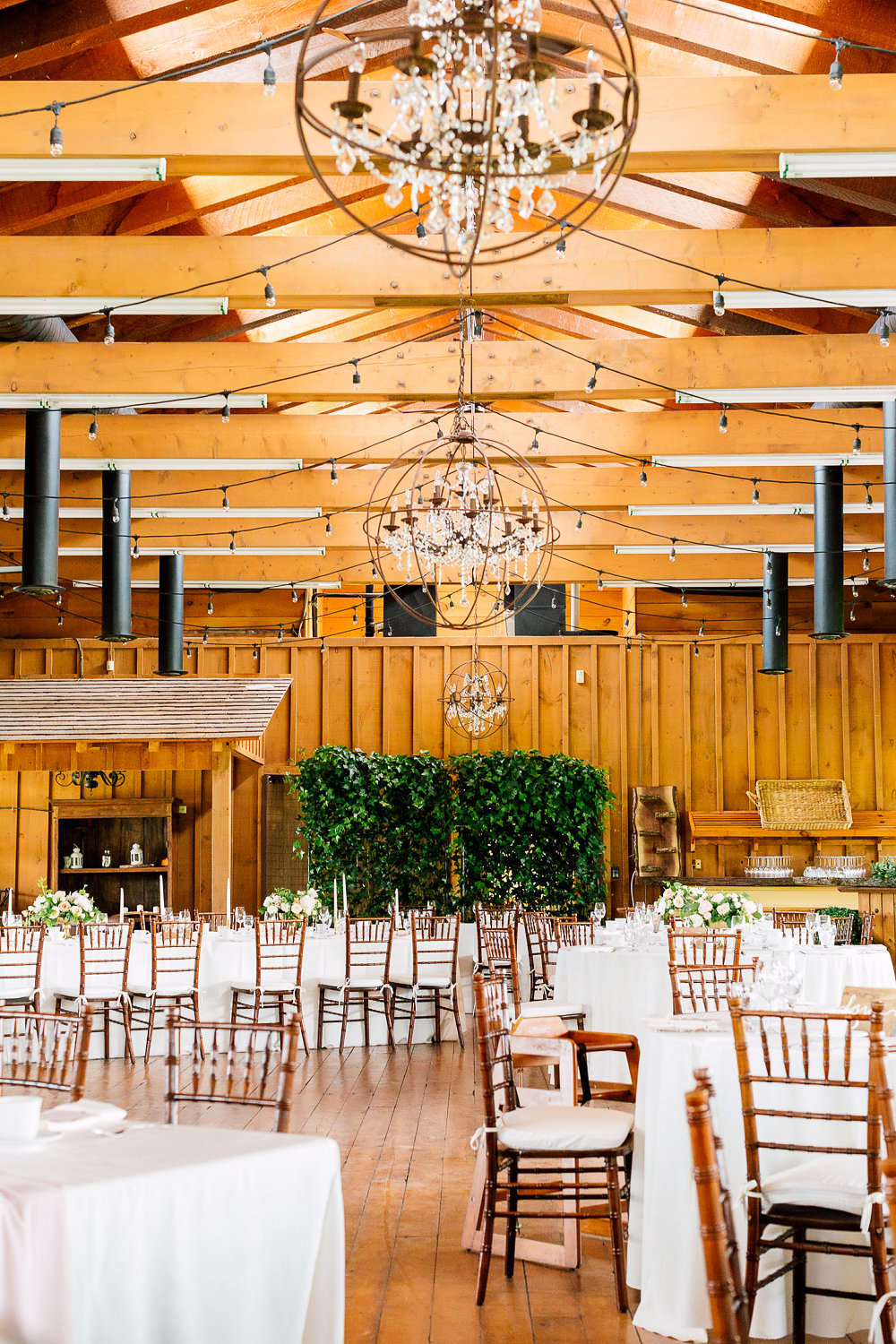 indoor wedding receptions - photo by Purple Tree Photography http://ruffledblog.com/charming-wine-country-wedding-at-kurtz-orchard