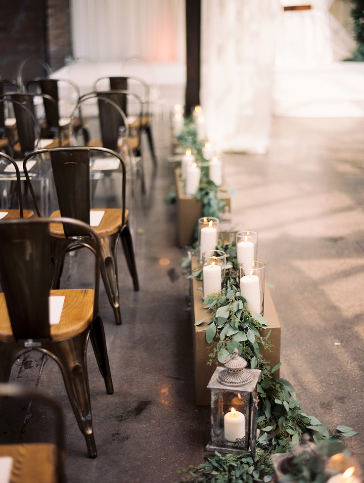 Chic Greenery Wedding at a Warehouse! See more: https://ruffledblog.com/chic-greenery-wedding/ #weddingvenue #ceremonydecor #greenerydecor
