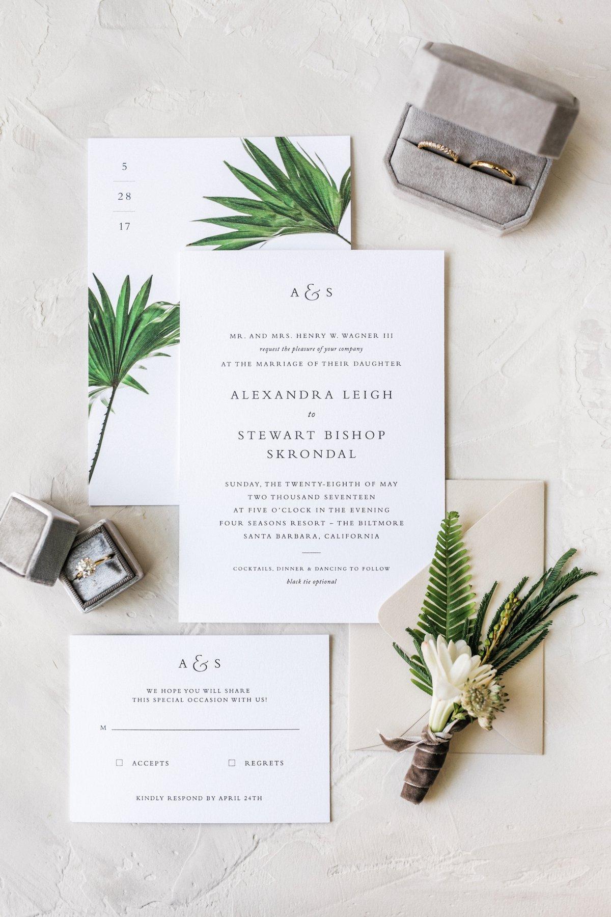 modern white wedding invitations - photo by Anna Delores http://ruffledblog.com/chic-modern-wedding-at-four-seasons-santa-barbara