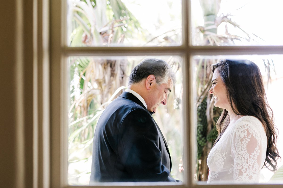 bride and father first looks - photo by Anna Delores https://ruffledblog.com/chic-modern-wedding-at-four-seasons-santa-barbara