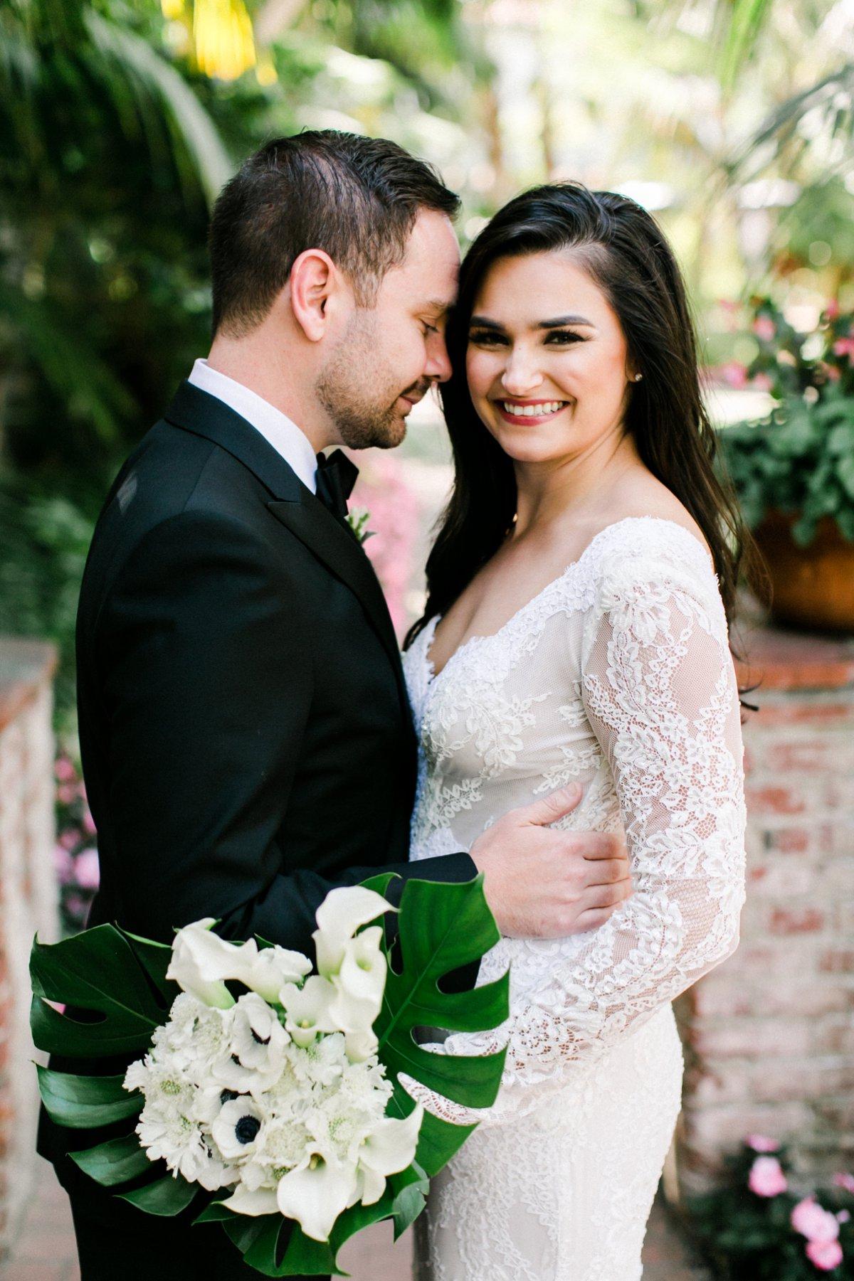 lace sleeve wedding dresses - photo by Anna Delores https://ruffledblog.com/chic-modern-wedding-at-four-seasons-santa-barbara