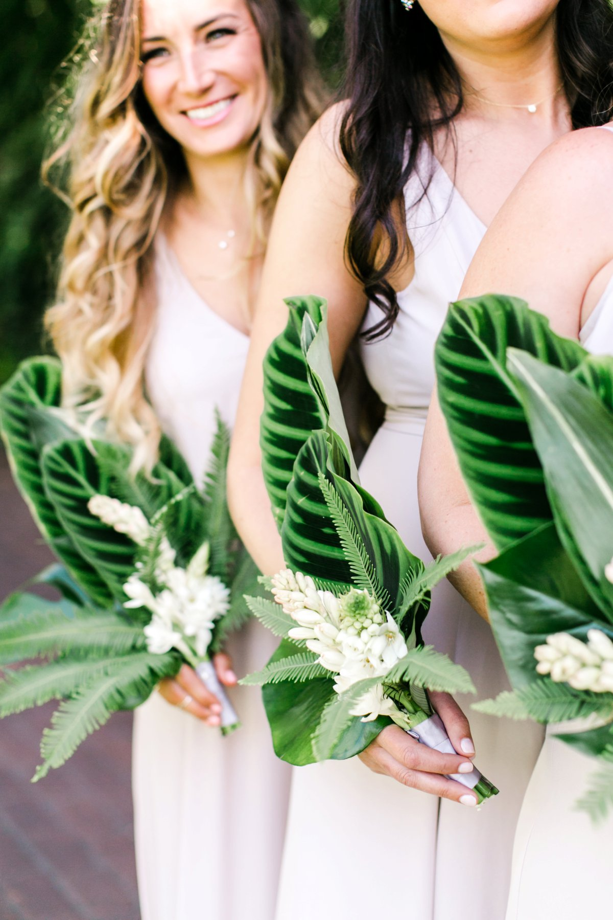 tropical bridesmaid bouquets - photo by Anna Delores https://ruffledblog.com/chic-modern-wedding-at-four-seasons-santa-barbara
