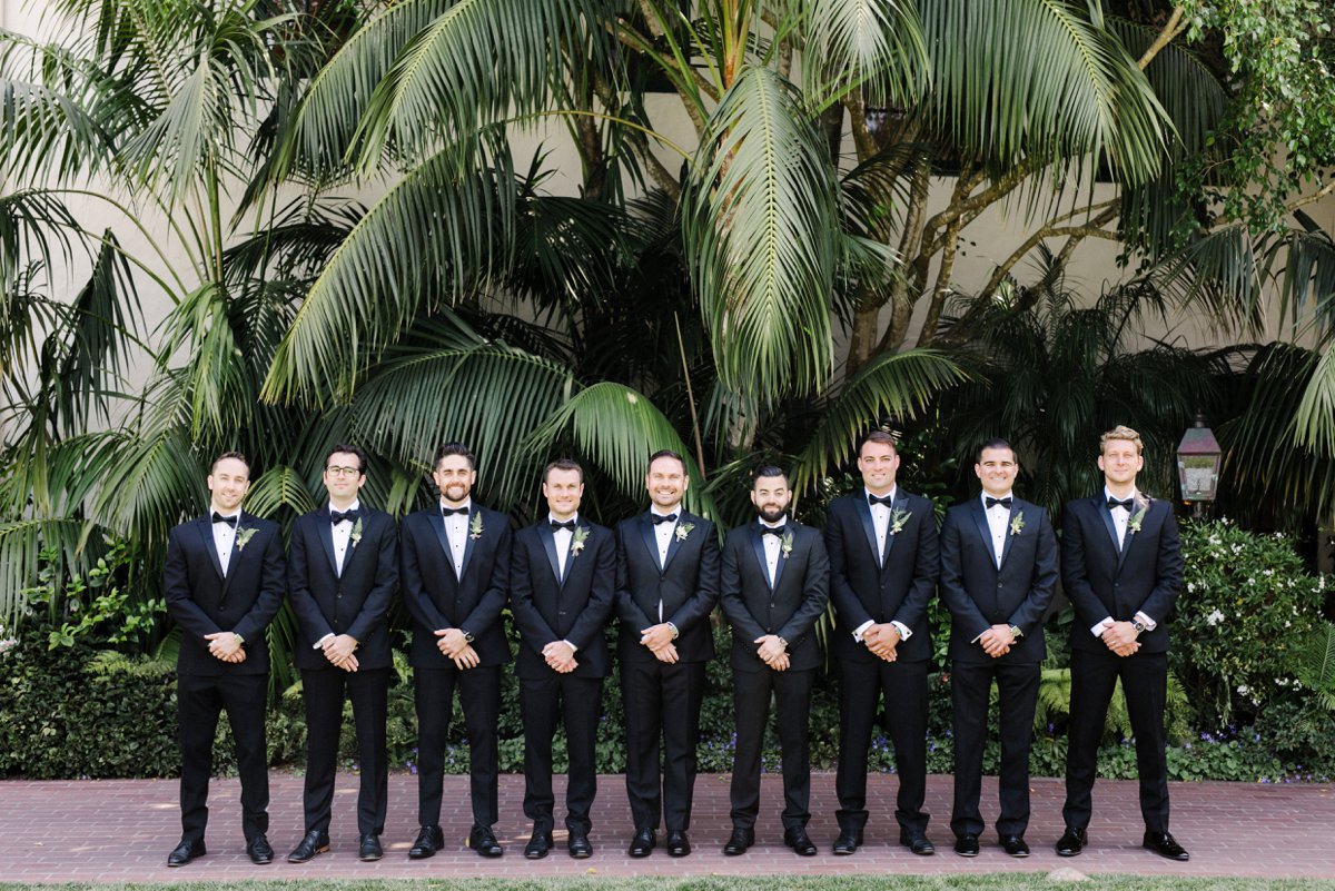 black tie groomsmen - photo by Anna Delores https://ruffledblog.com/chic-modern-wedding-at-four-seasons-santa-barbara