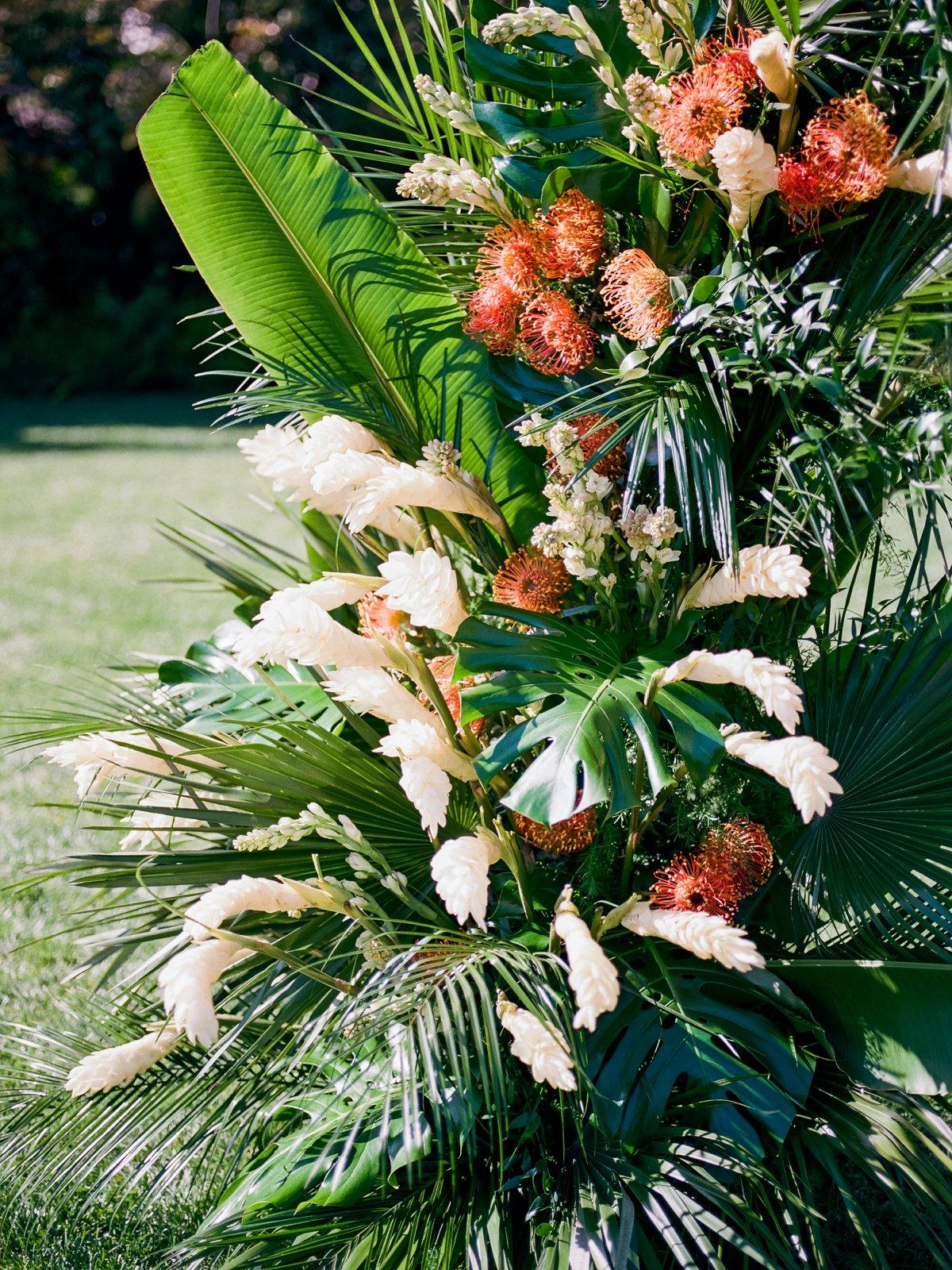 tropical flowers at weddings - photo by Anna Delores http://ruffledblog.com/chic-modern-wedding-at-four-seasons-santa-barbara