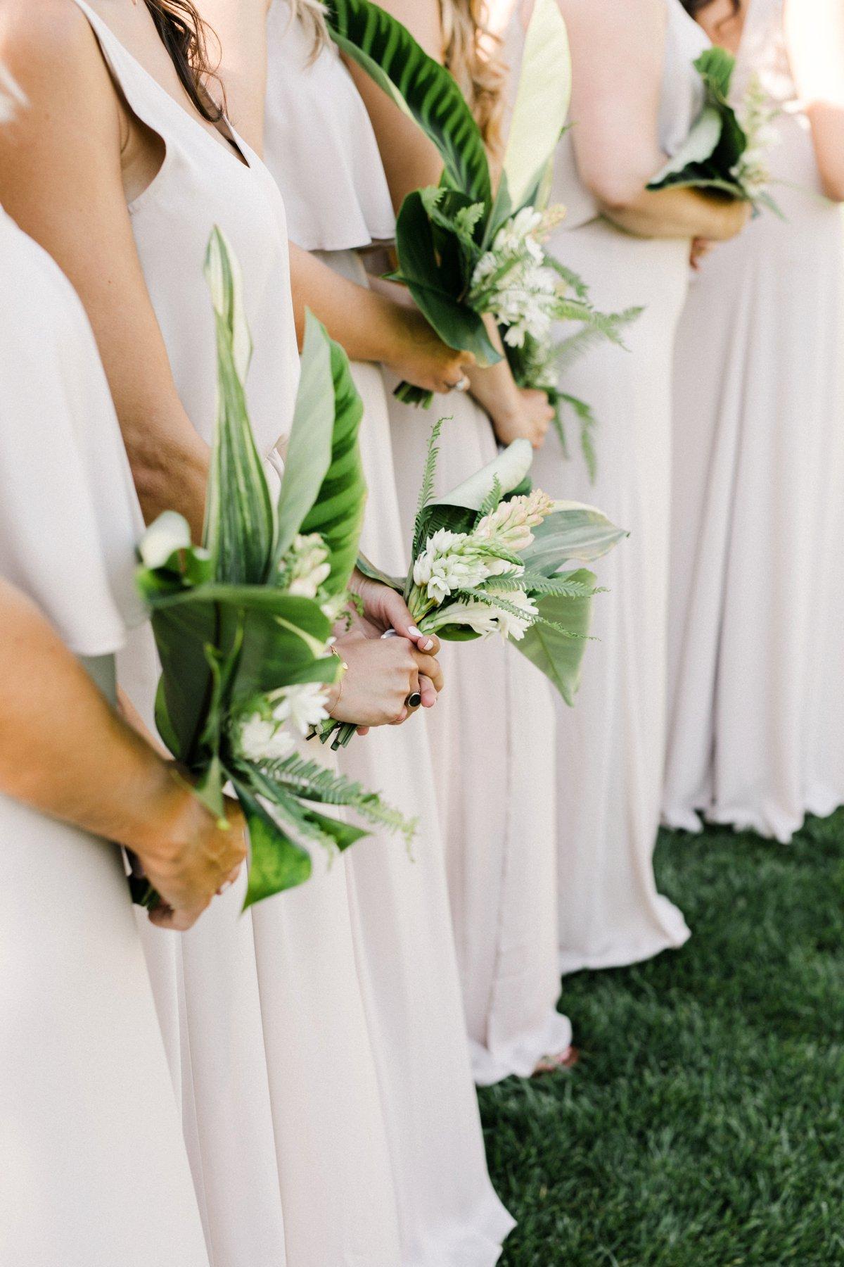 tropical greenery wedding bouquets - photo by Anna Delores http://ruffledblog.com/chic-modern-wedding-at-four-seasons-santa-barbara