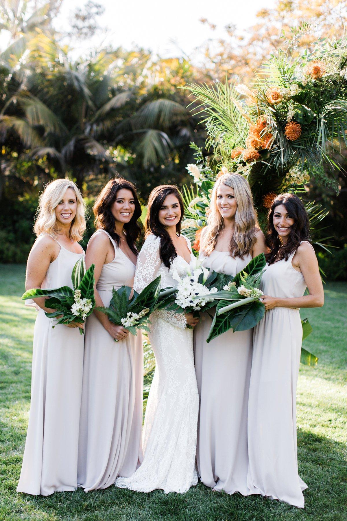 neutral bridesmaid dresses - photo by Anna Delores https://ruffledblog.com/chic-modern-wedding-at-four-seasons-santa-barbara