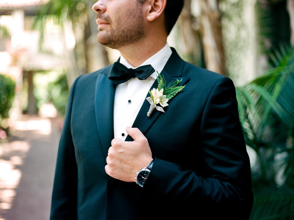 black tie boutonnieres - photo by Anna Delores https://ruffledblog.com/chic-modern-wedding-at-four-seasons-santa-barbara
