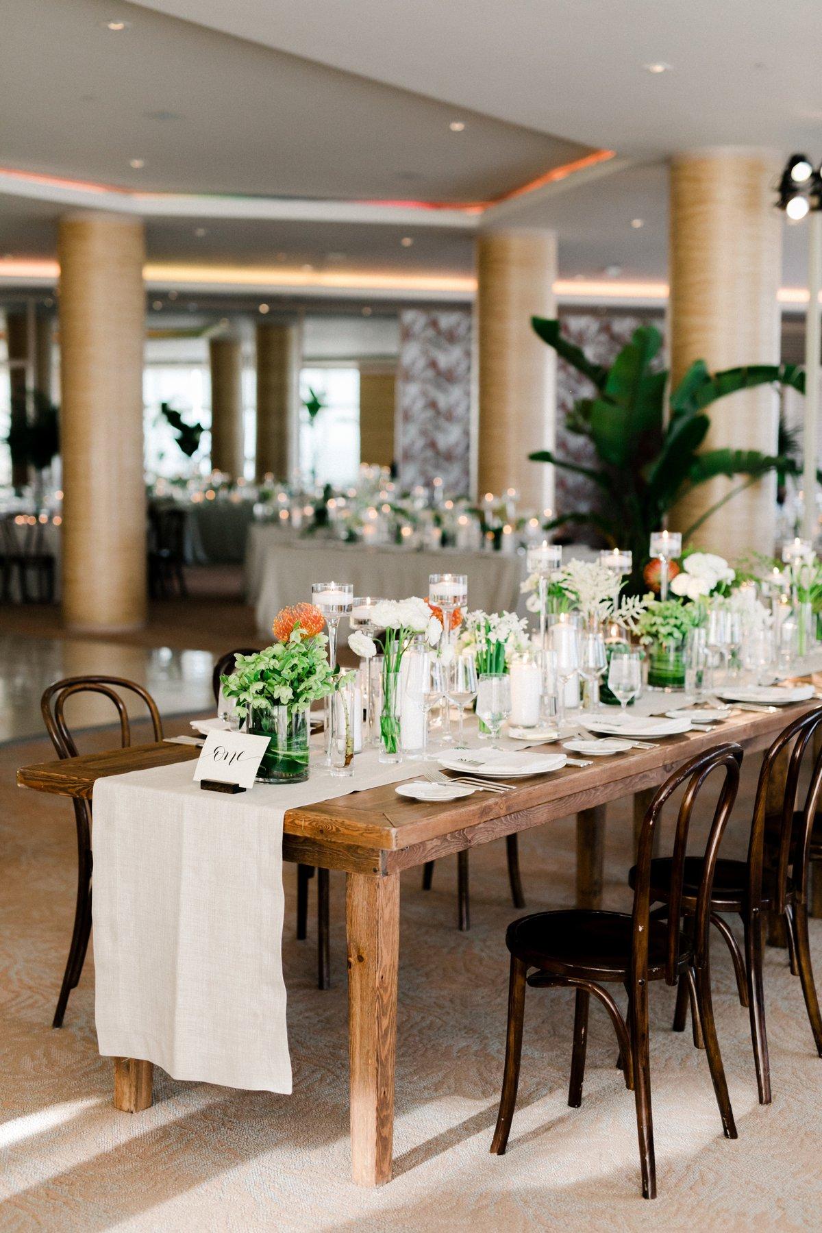 tropical inspired wedding receptions - photo by Anna Delores https://ruffledblog.com/chic-modern-wedding-at-four-seasons-santa-barbara