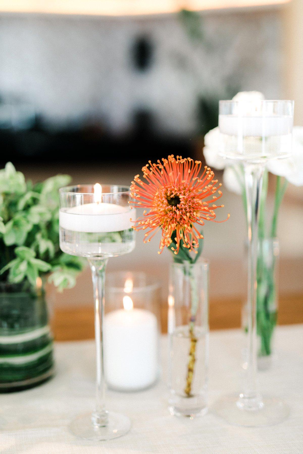 orange pincushions - photo by Anna Delores http://ruffledblog.com/chic-modern-wedding-at-four-seasons-santa-barbara
