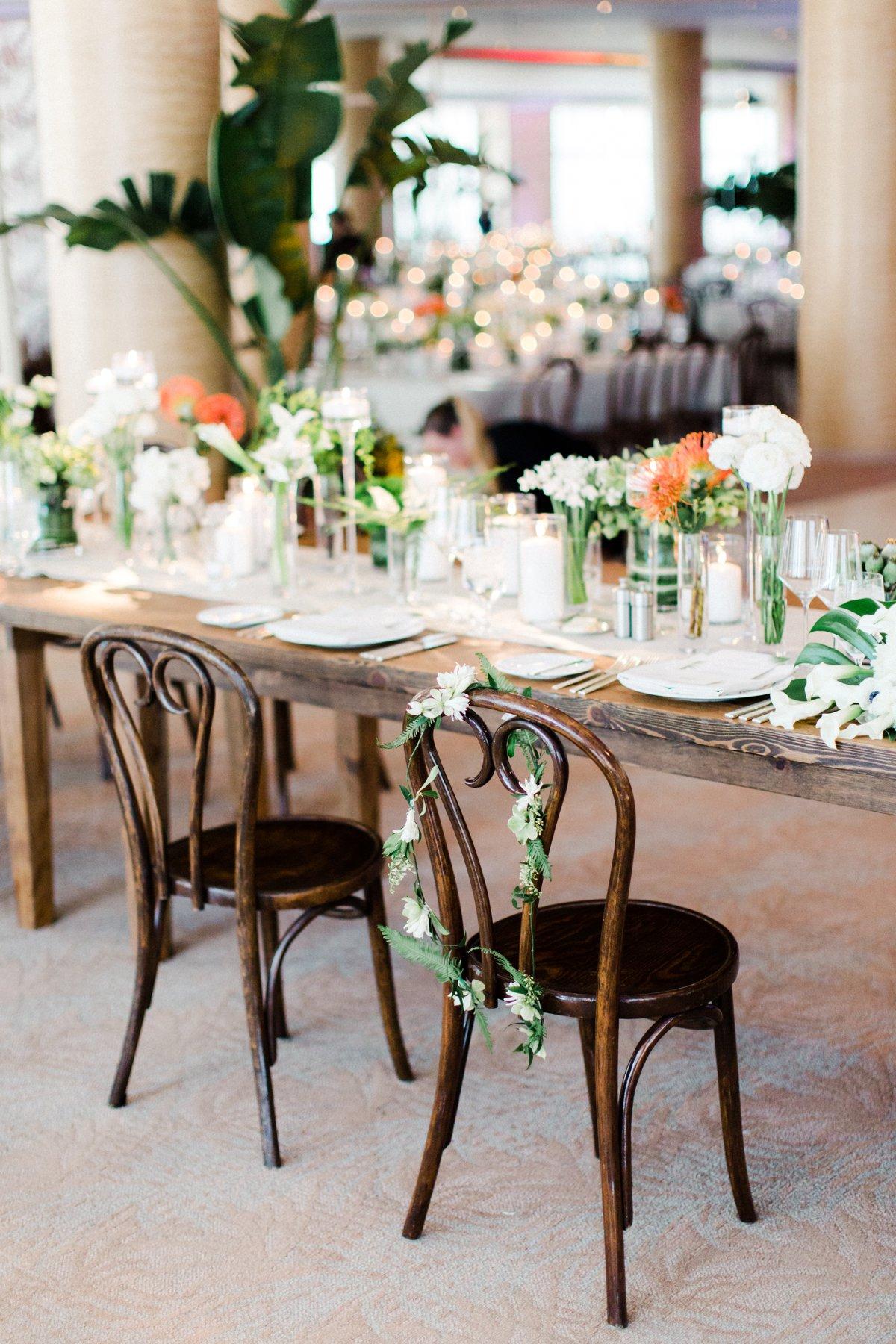 tropical wedding sweetheart tables - photo by Anna Delores http://ruffledblog.com/chic-modern-wedding-at-four-seasons-santa-barbara