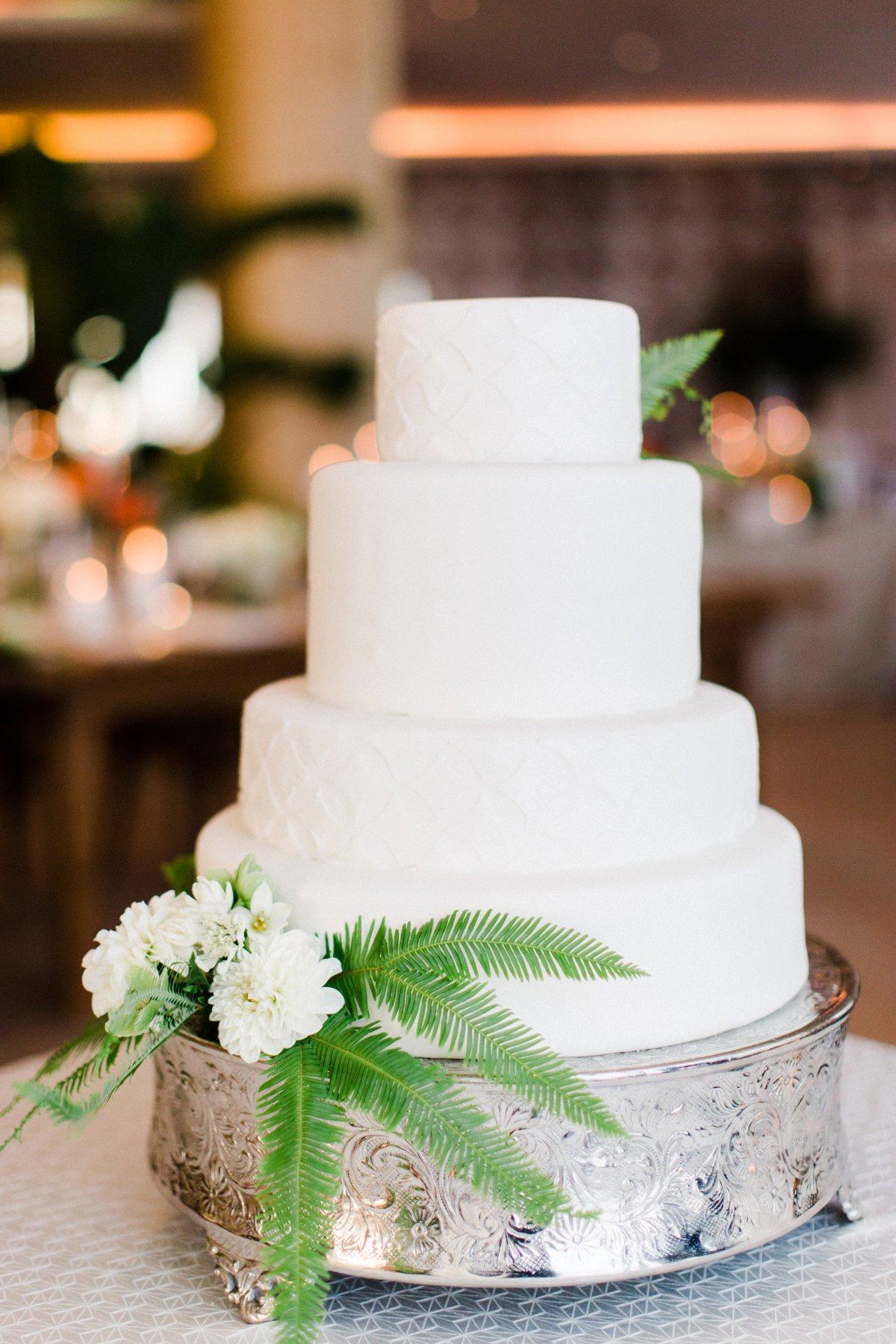 modern white wedding cakes - photo by Anna Delores http://ruffledblog.com/chic-modern-wedding-at-four-seasons-santa-barbara