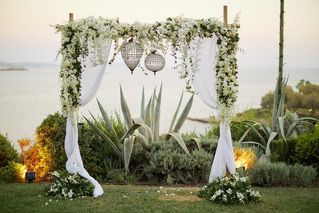 romantic sunset wedding ceremonies - photo by Sotiris Tsakanikas http://ruffledblog.com/chic-sunset-wedding-on-the-athens-riviera