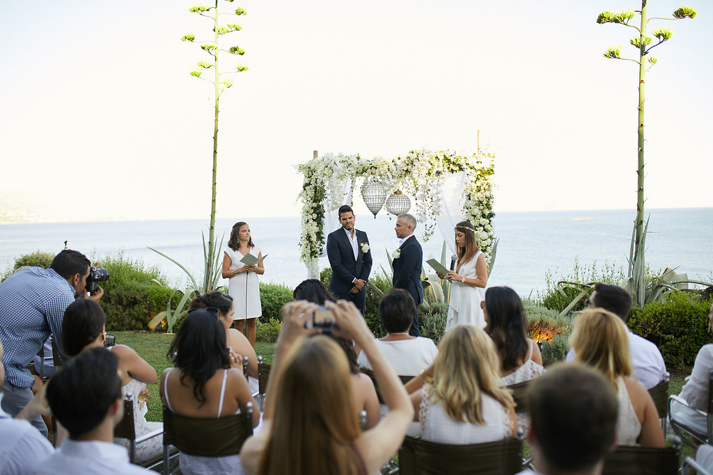 waterside wedding ceremonies - photo by Sotiris Tsakanikas https://ruffledblog.com/chic-sunset-wedding-on-the-athens-riviera