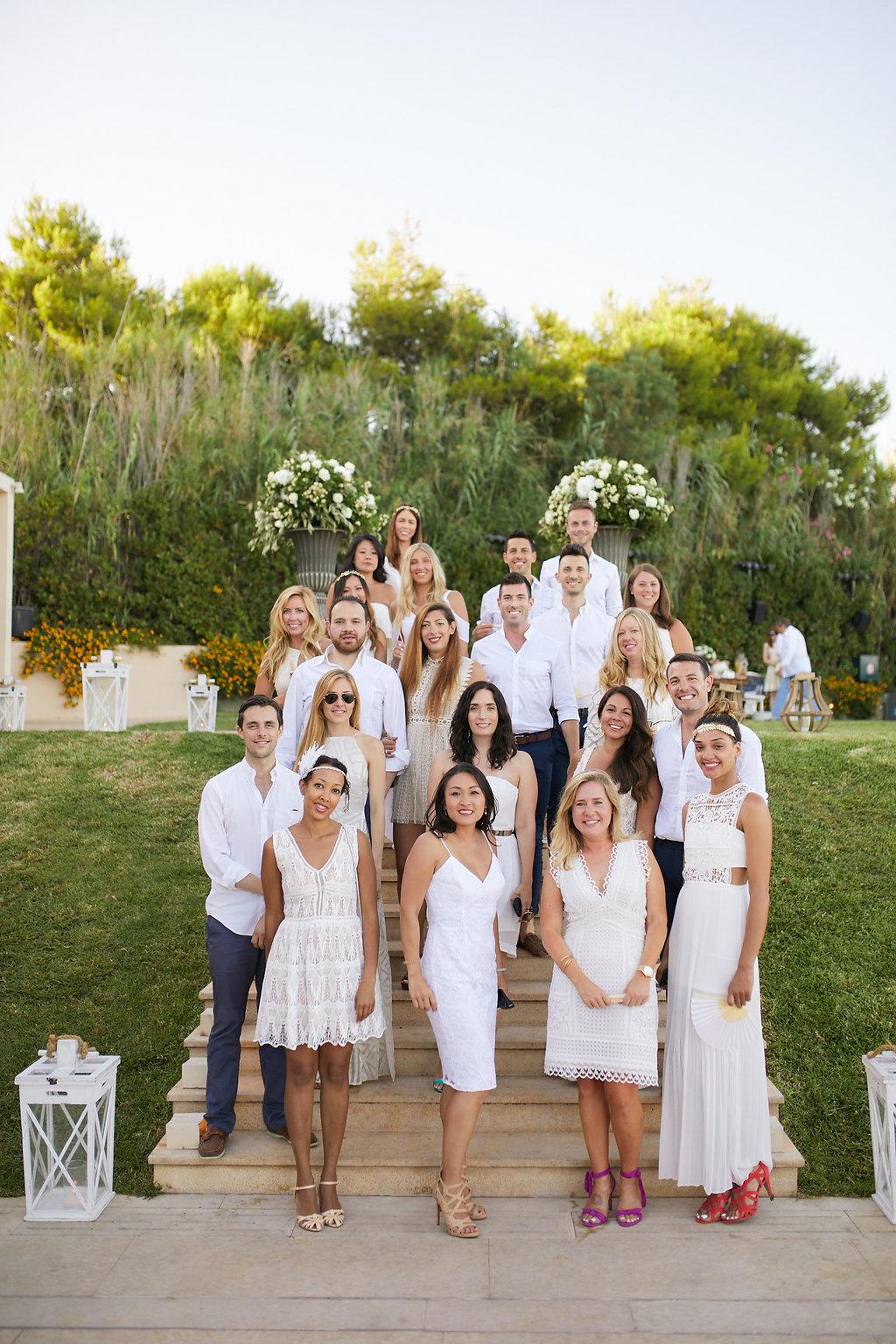 all white dress code weddings - photo by Sotiris Tsakanikas https://ruffledblog.com/chic-sunset-wedding-on-the-athens-riviera