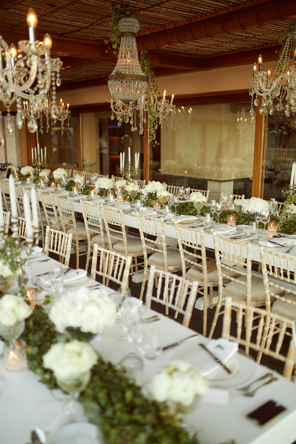 romantic wedding tables - photo by Sotiris Tsakanikas http://ruffledblog.com/chic-sunset-wedding-on-the-athens-riviera