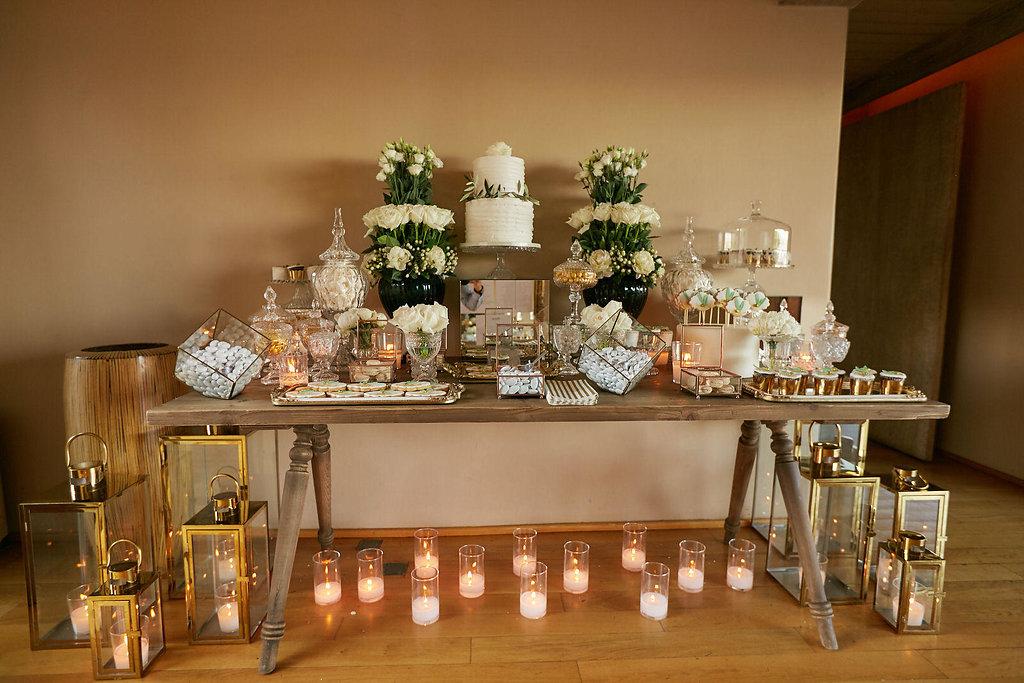 wedding cake tables - photo by Sotiris Tsakanikas https://ruffledblog.com/chic-sunset-wedding-on-the-athens-riviera