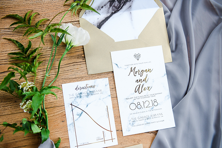 marble wedding invitations - photo by Kate Noelle Photography https://ruffledblog.com/chic-wedding-ideas-inspired-by-partly-cloudy-skies