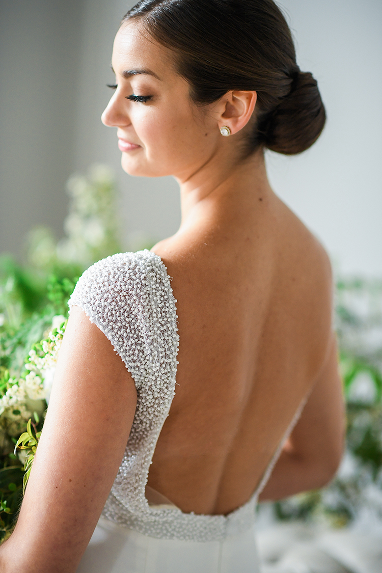 romantic wedding dresses - photo by Kate Noelle Photography http://ruffledblog.com/chic-wedding-ideas-inspired-by-partly-cloudy-skies