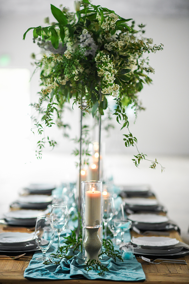 tall greenery centerpieces - photo by Kate Noelle Photography http://ruffledblog.com/chic-wedding-ideas-inspired-by-partly-cloudy-skies