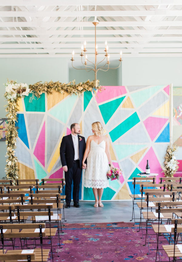 colorful geometric ceremony backdrop - photo by Chloe Moore Photography https://ruffledblog.com/40-eye-catching-geometric-wedding-ideas