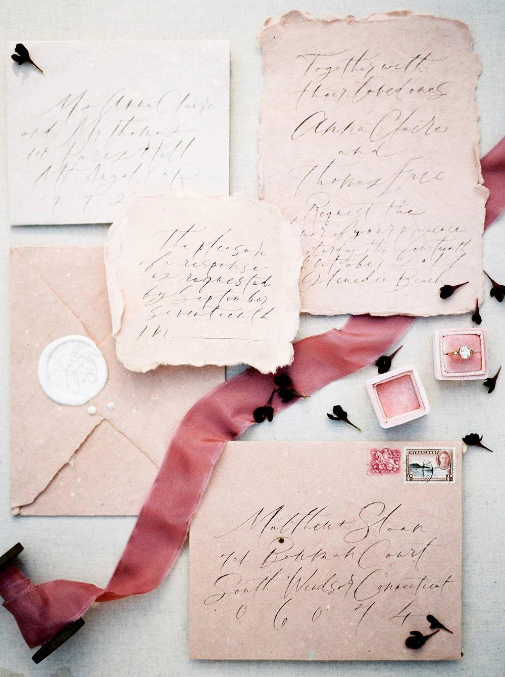 pink wedding invitations with scripty calligraphy