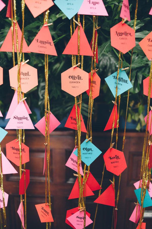geometric paper escort cards - photo by Chris Howard https://ruffledblog.com/40-eye-catching-geometric-wedding-ideas
