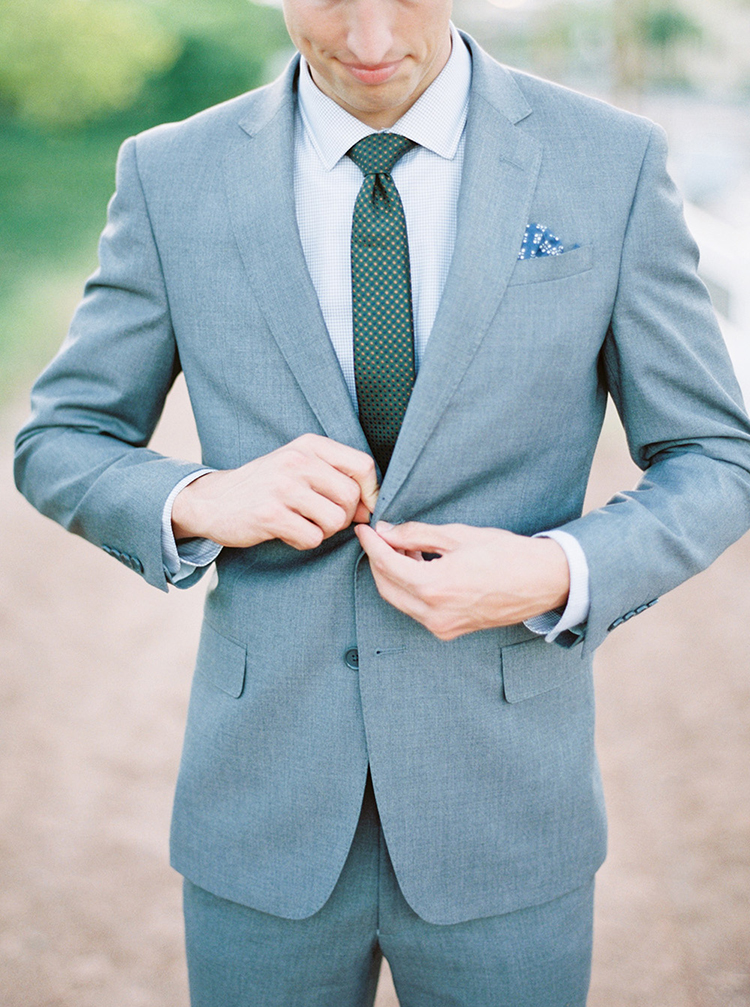 grey grooms suits - photo by Melissa Jill Photography https://ruffledblog.com/citrus-and-copper-orchard-wedding-inspiration