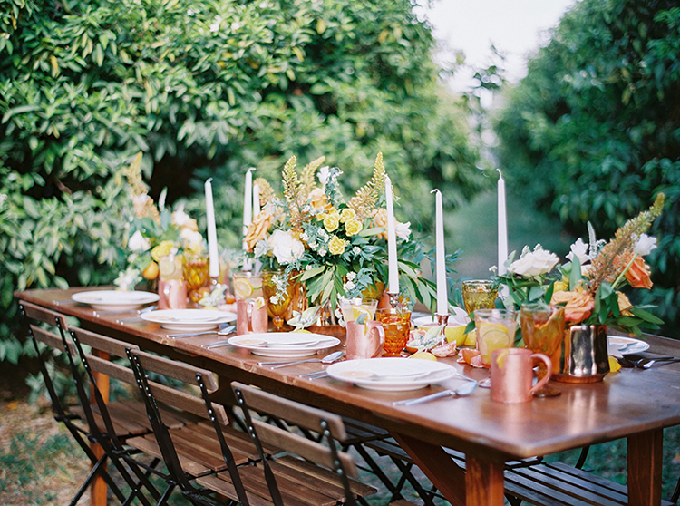 tablescapes with amber bottles - photo by Melissa Jill Photography https://ruffledblog.com/citrus-and-copper-orchard-wedding-inspiration