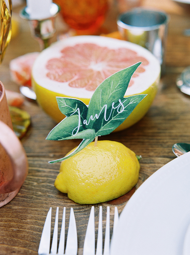 lemon name cards - photo by Melissa Jill Photography https://ruffledblog.com/citrus-and-copper-orchard-wedding-inspiration